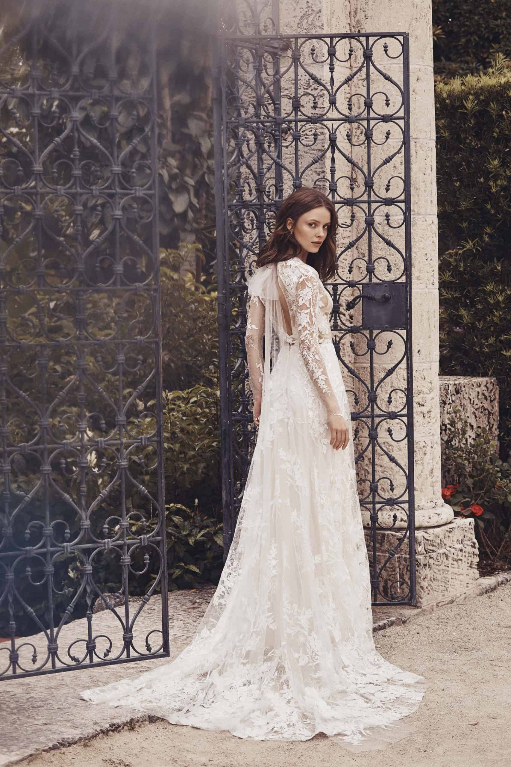 a laced wedding dress with long lace sleeves by Monique Lhuillier