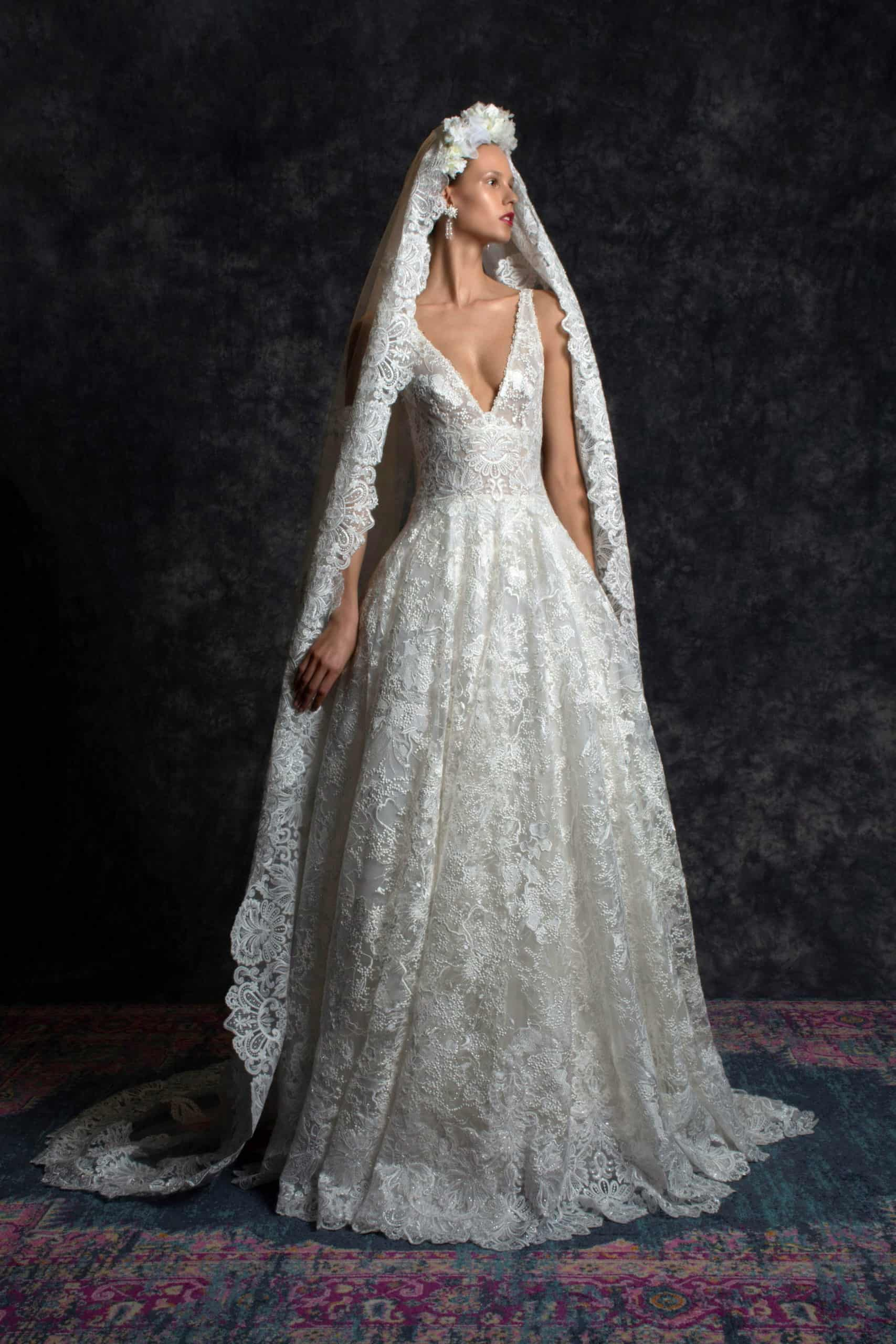 classic lased a-line wedding dress with a veil by Naeem Khan