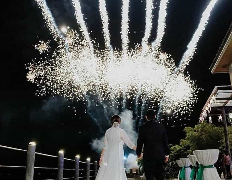 White, large firework show for a wedding, newlyweds admiring, by NightLights Fireworks.