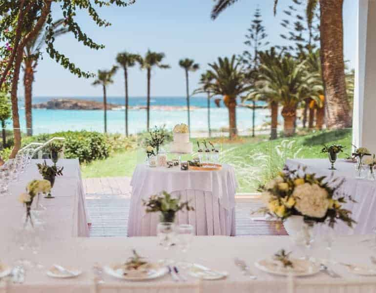 A wedding reception dinner next to the beach located at Nissi Beach Resort.