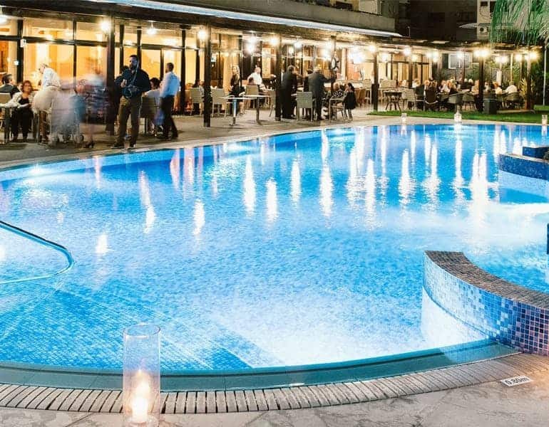 Pool with night lights at a wedding reception dinner at Odysseia Hotel in Cyprus.