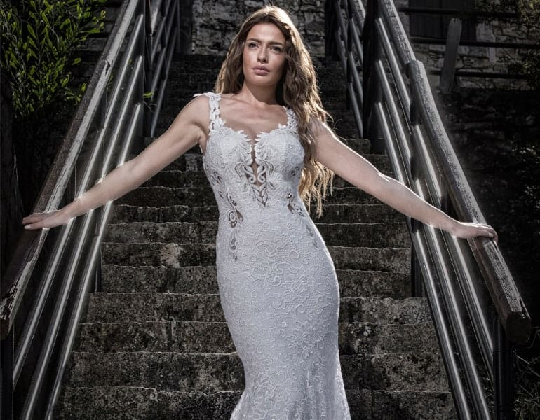 Summer wedding dress worn by a brunette model, design by Optasia Exclusive in Cyprus.