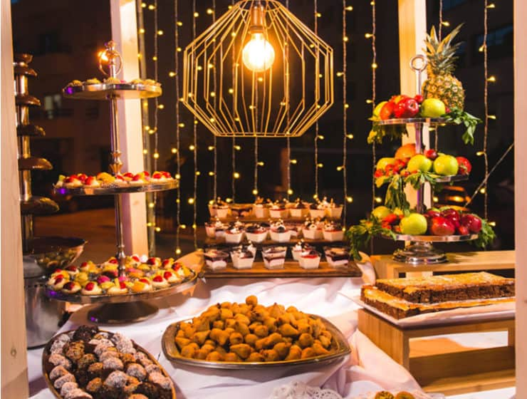 Wedding catering desserts with lighting display by Oriental Catering.
