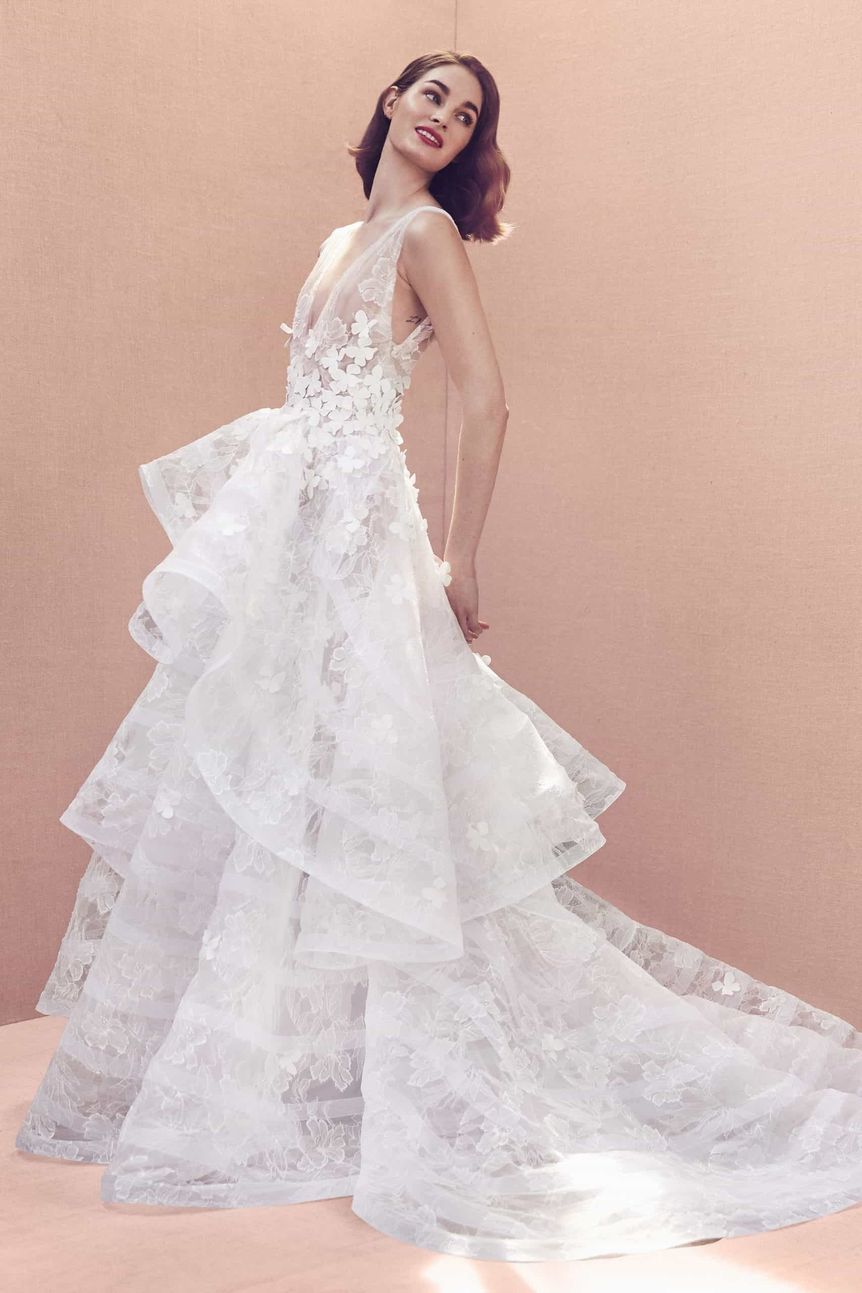 laced wedding dress with a layering skirt and tail by Oscar de la Renta