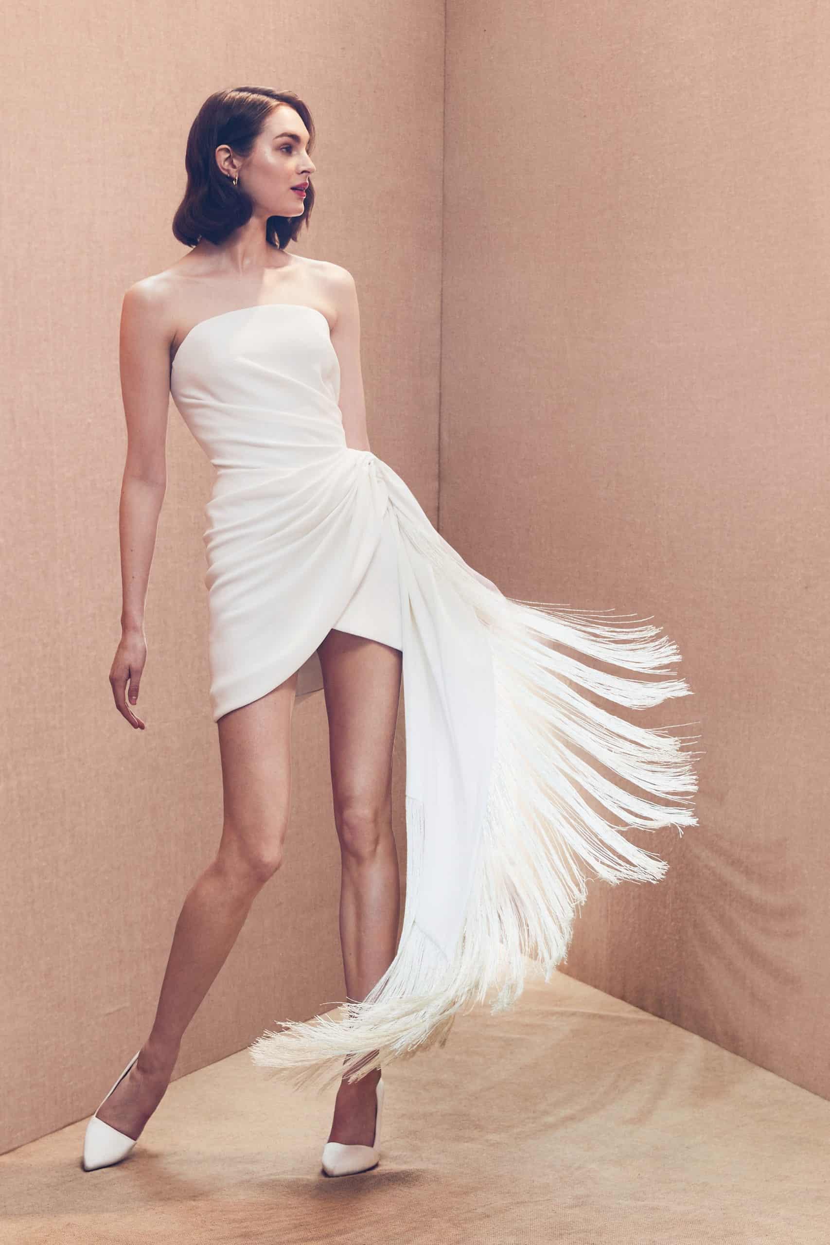 a short strapless wedding dress with a feather tail by Oscar de la Renta