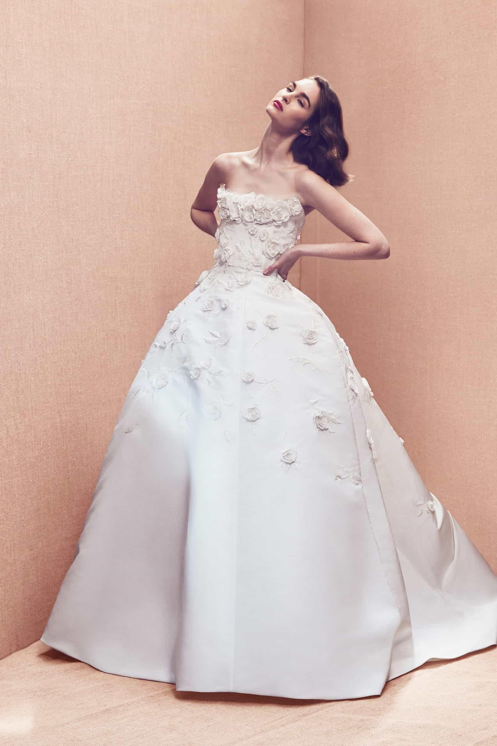 a-line strapless wedding dress with embossed flower by Oscar de la Renta