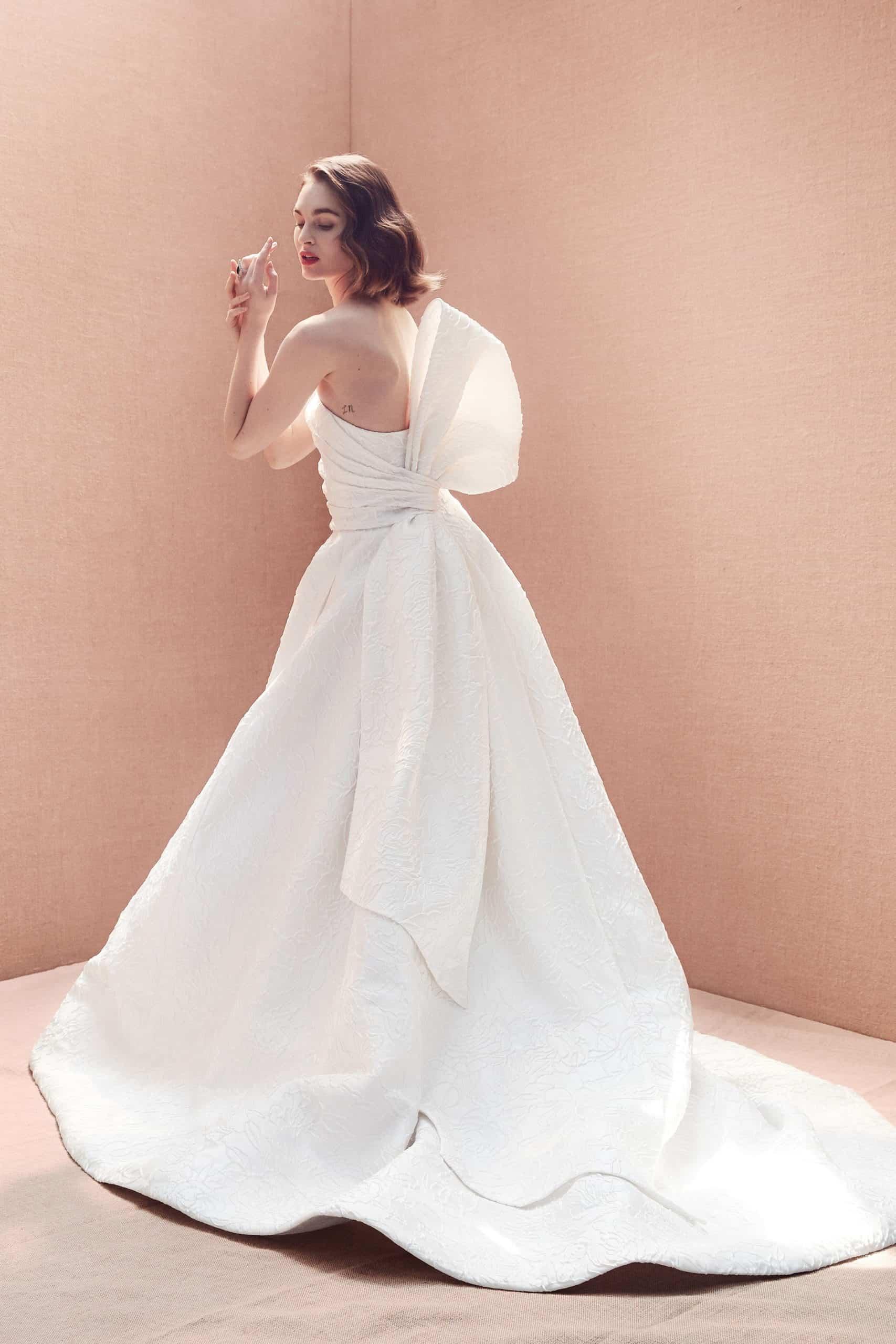 a-line strapless wedding dress with a huge back bow by Oscar de la Renta