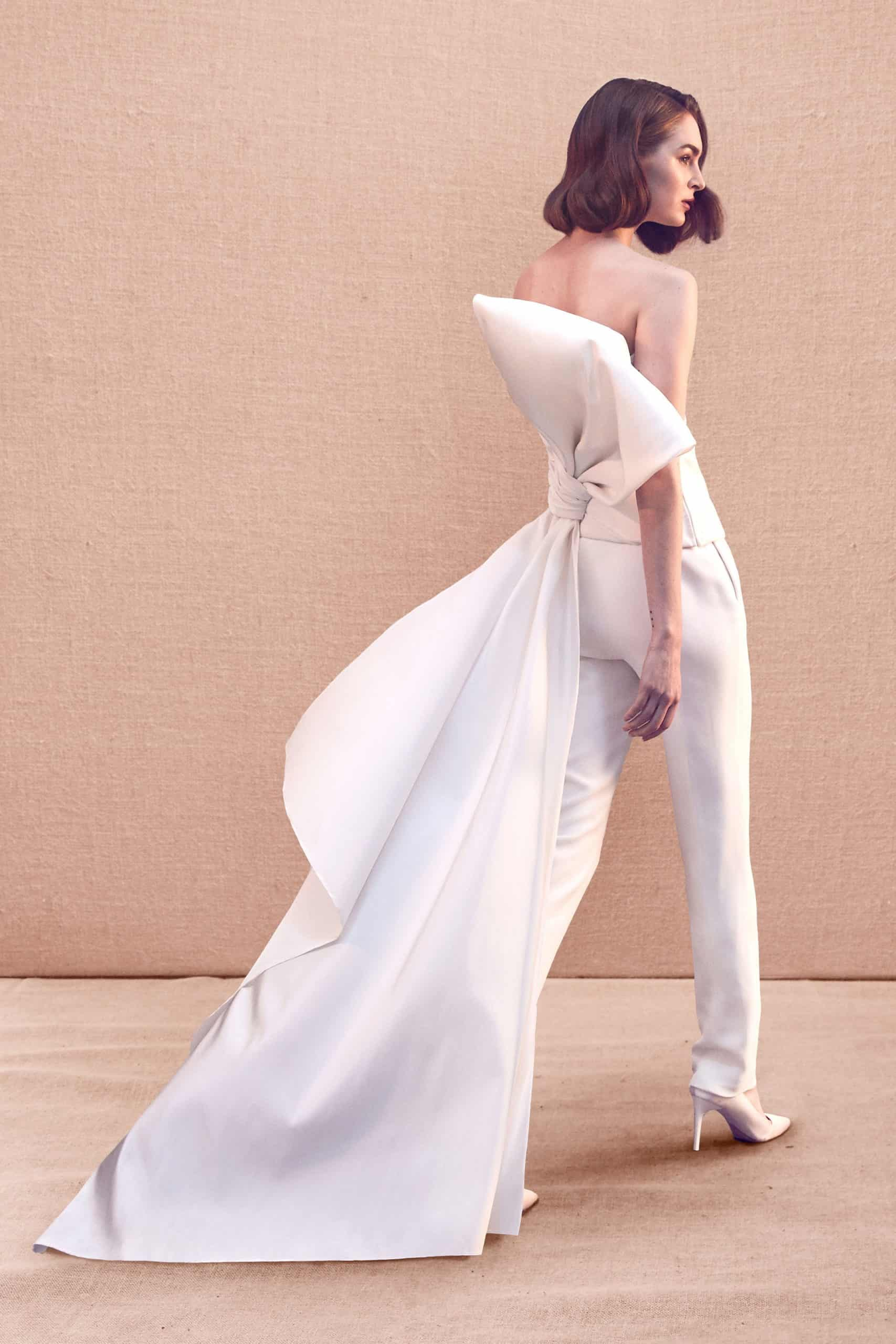 strapless wedding jumpsuit with back huge bow with a tail by Oscar de la Renta