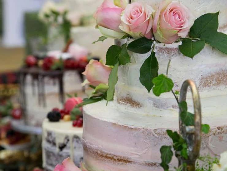 A wedding cake decorated with roses, made by Pandora Bakeries in Cyprus.