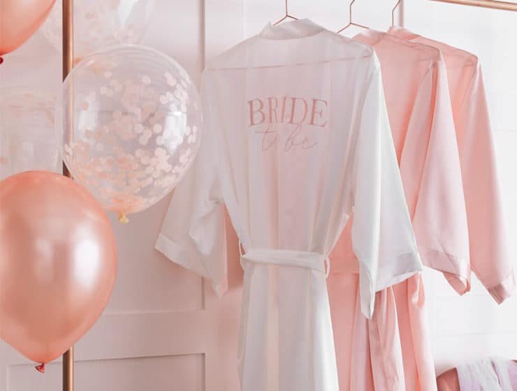 Pink bridal robes and balloons by Pergamos Bachelorette.
