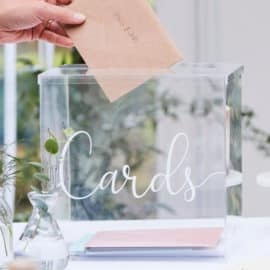 A clear plastic box for wedding Thank You cards, offered by Pergamos Wedding Decorations in Cyprus.