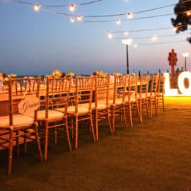 """Wedding table and a """"LOVE"""" sign with lights at Poseidonia Beach Hotel in Cyprus."""