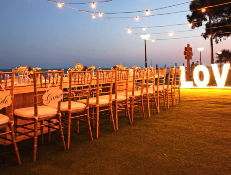 """Wedding table and a """"LOVE"""" sign with lights at Poseidonia Hotel in Cyprus."""