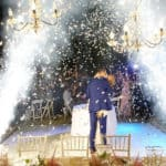 Newlywed couple kissing while celebratory fireworks and sparklers are going off, by MJD Pyrgos Fireworks and Special Effects.