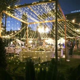 Fairy lights and lighting decoration shown at wedding dinner, designed by Recital Theama & Politismos.