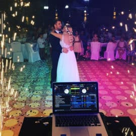 Large floor sparkler fireworks and DJ booth at a wedding, by Sound Art Services.