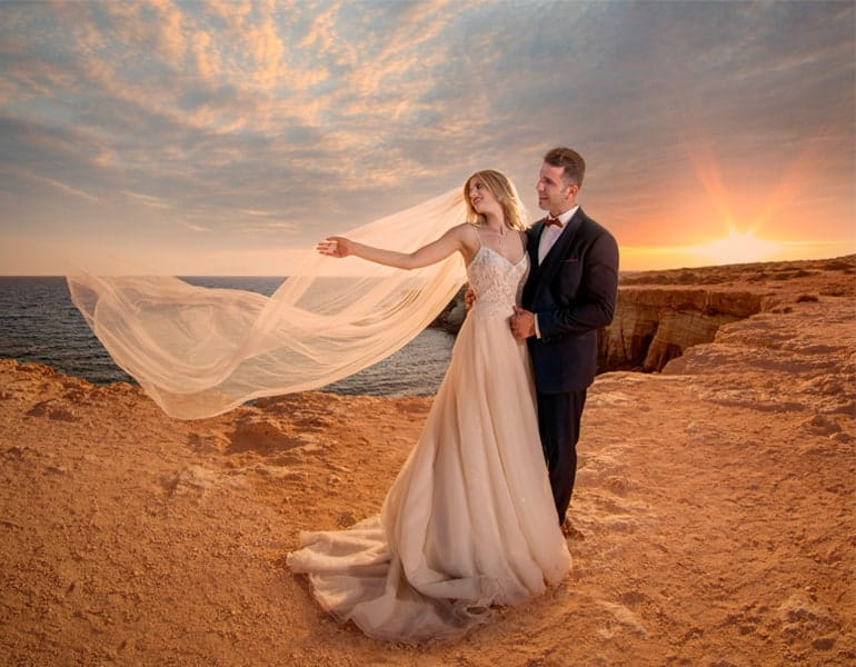 Well-edited photo of an engaged couple at seaside cliffs, by Studio Ena.