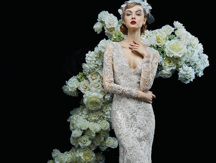 A model wearing a tight, semi-see-through wedding dress, designed by Teokath in Cyprus.