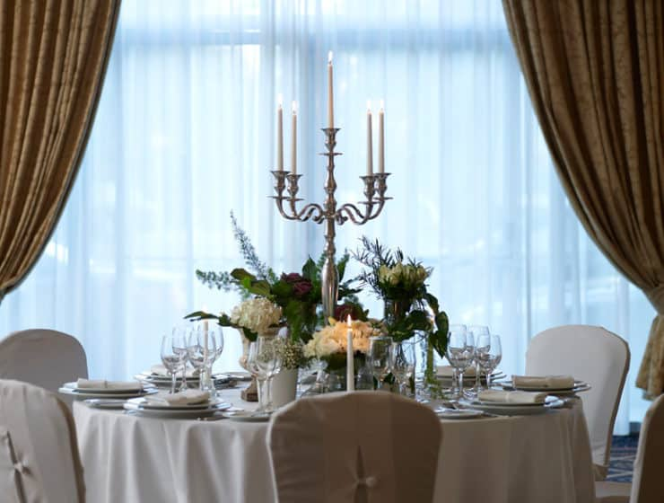 A wedding reception table and tableware with floral decorations, at the The Landmark Nicosia.