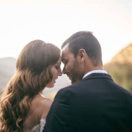 A newlywed couple intimately smiling, captured by Photo Studio Twins in Cyprus.