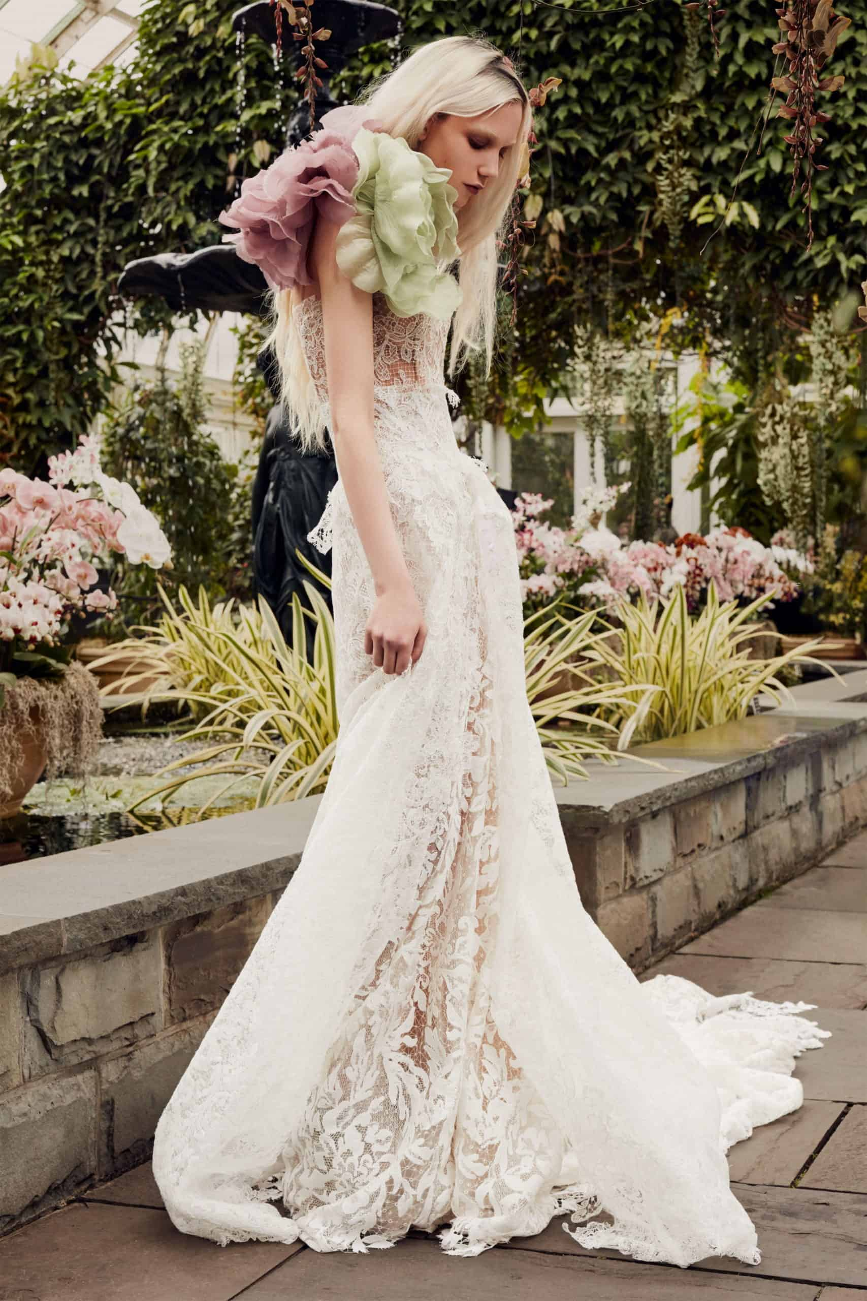 white laced wedding dress with pink and red tulle flowers by Vera Wang