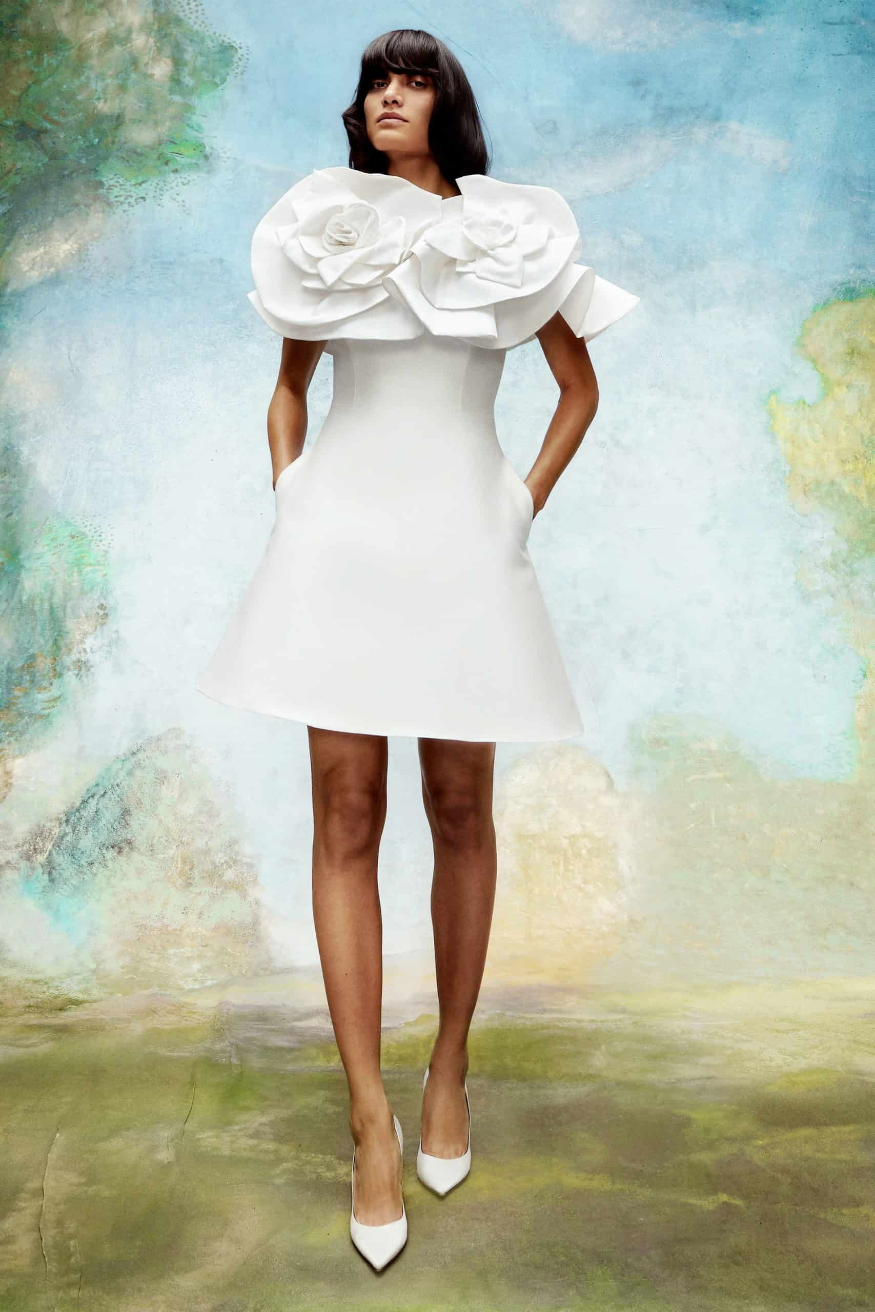 short wedding dress with floral extra volume collar by Viktor and Rolf
