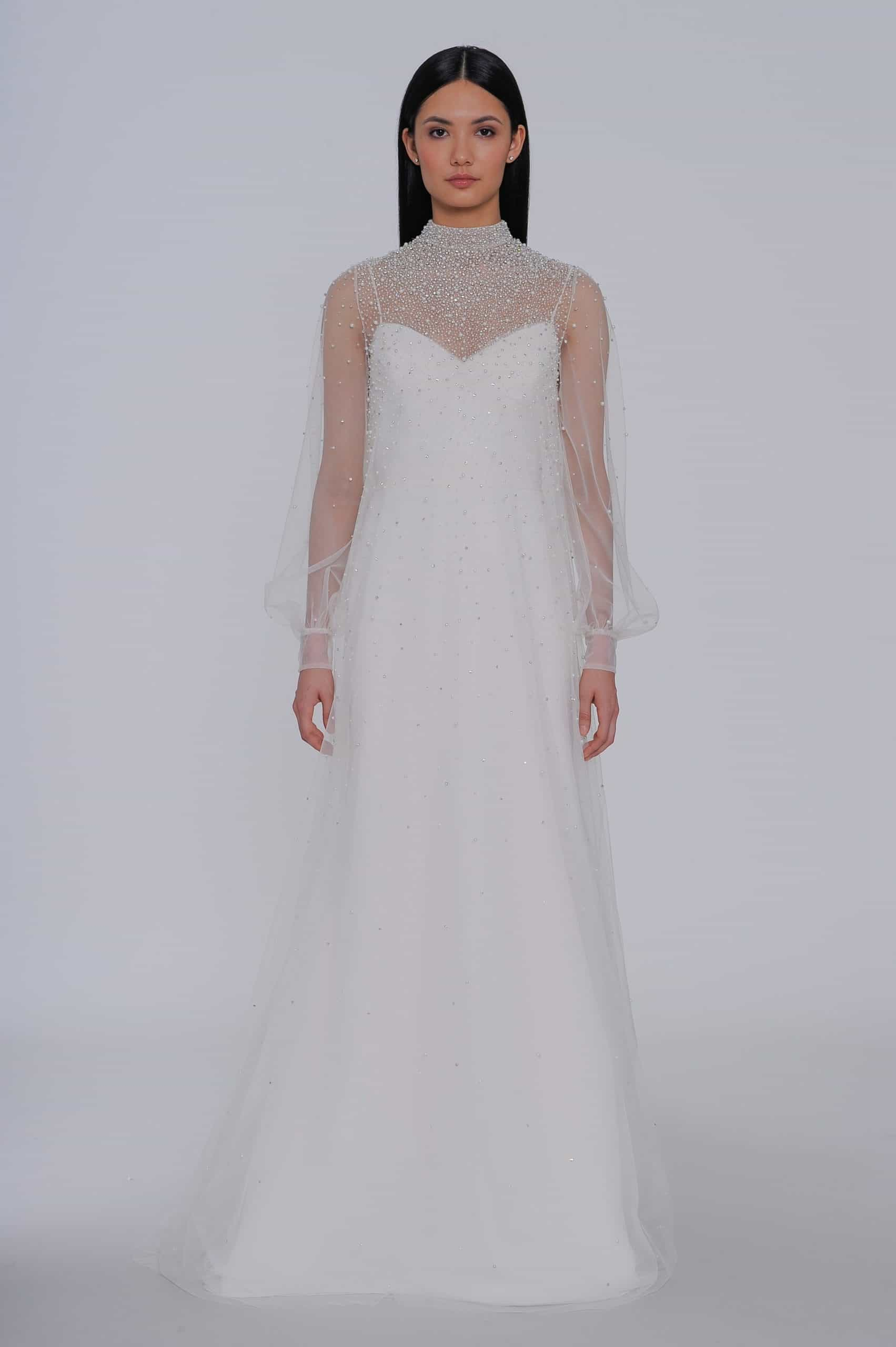 a-lined wedding dress with a tulle cape with pearls by Allison Webb