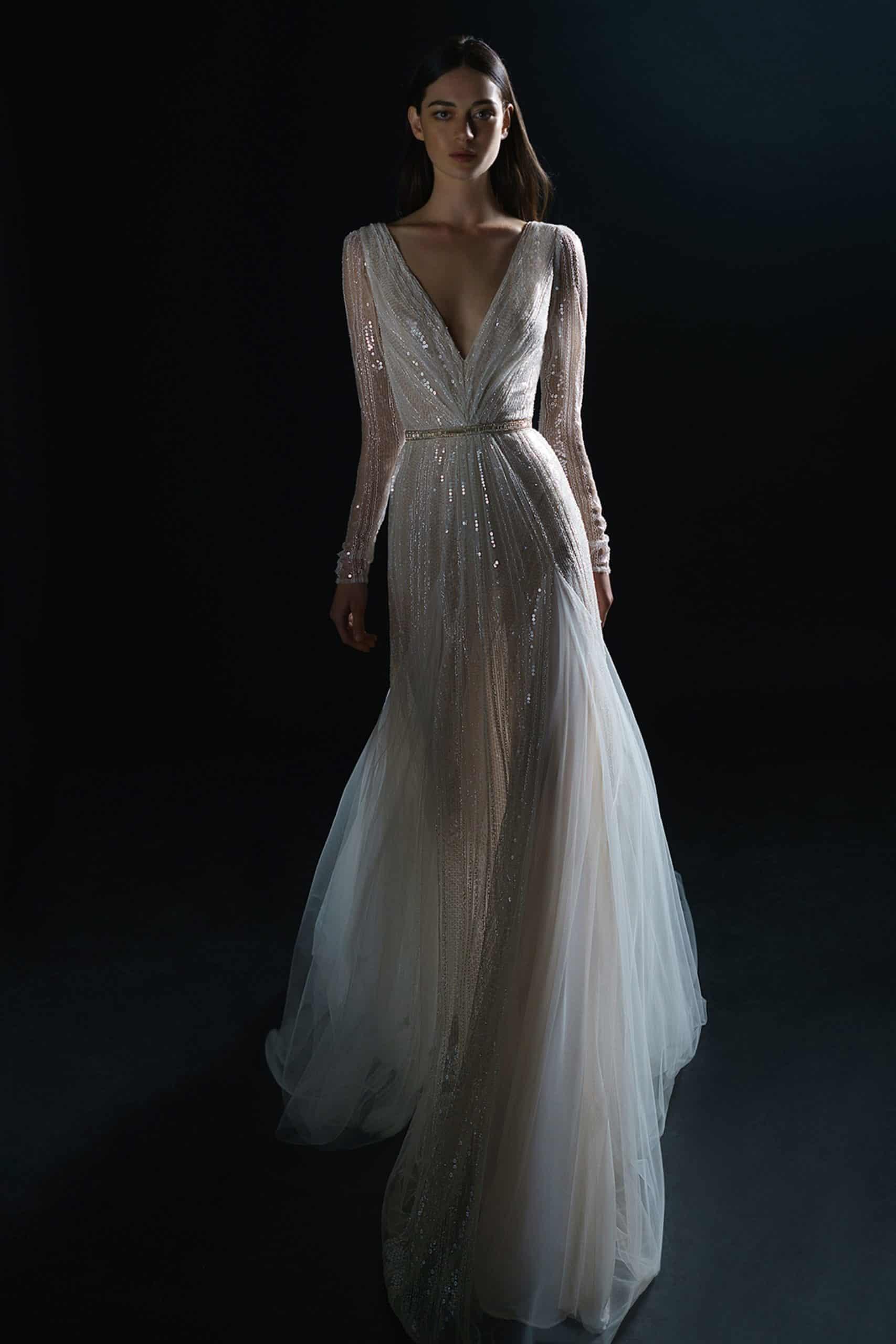 V-neck wedding dress with metallic details by Inbal Dror