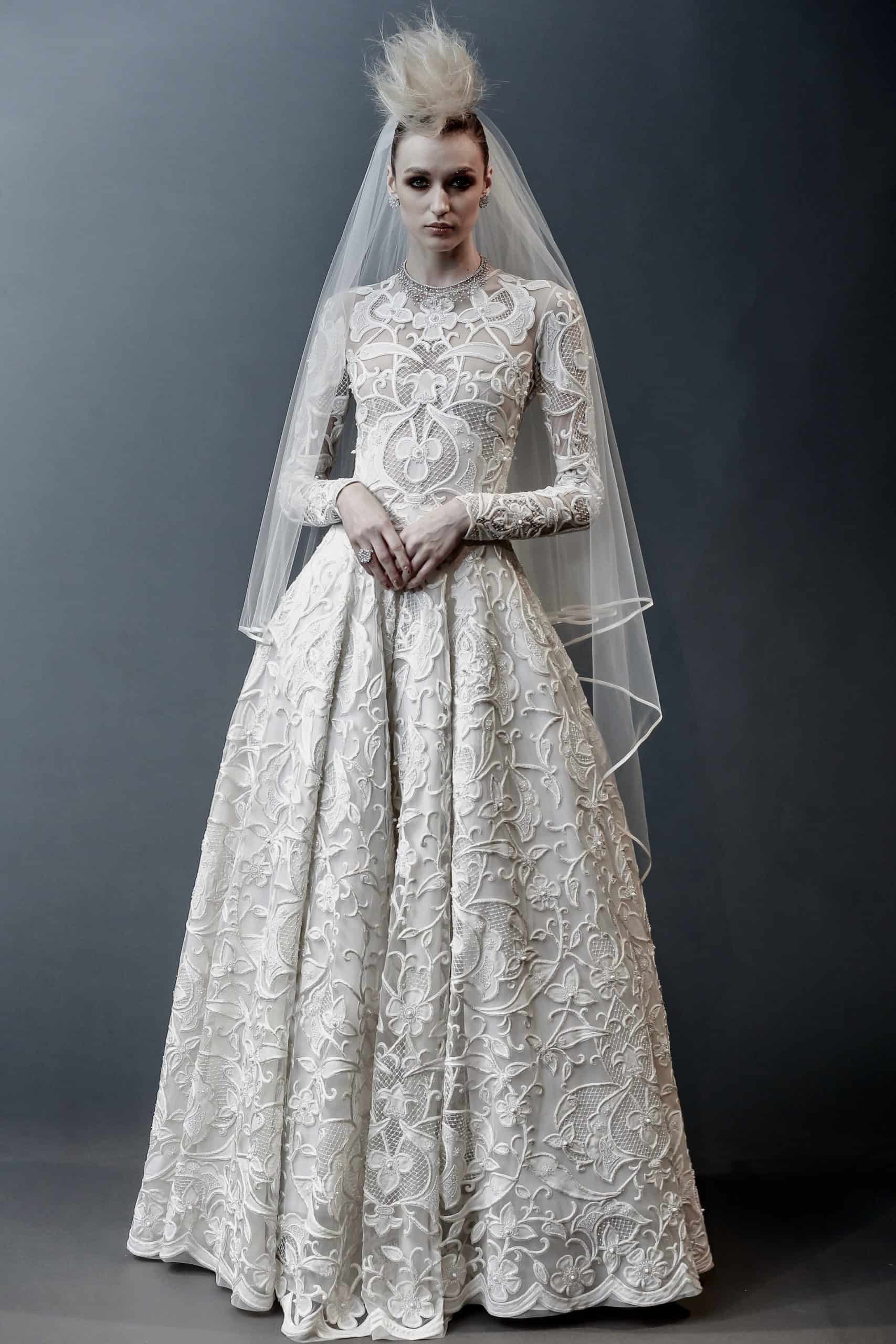 a royal princess wedding dress with embossed heavy lace by Naeem Khan