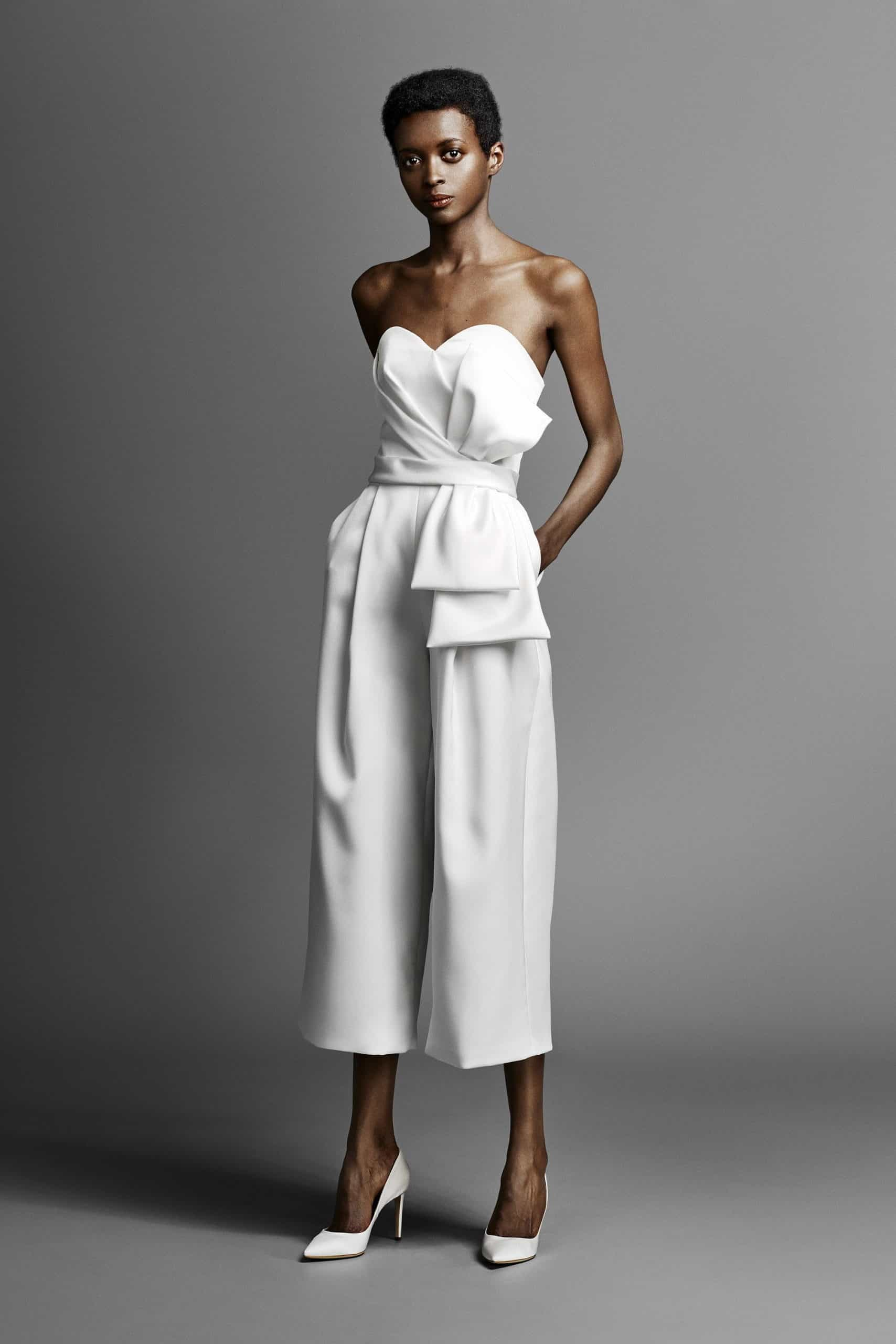 jumpsuit wedding dress with a bow by Viktor and Rolf