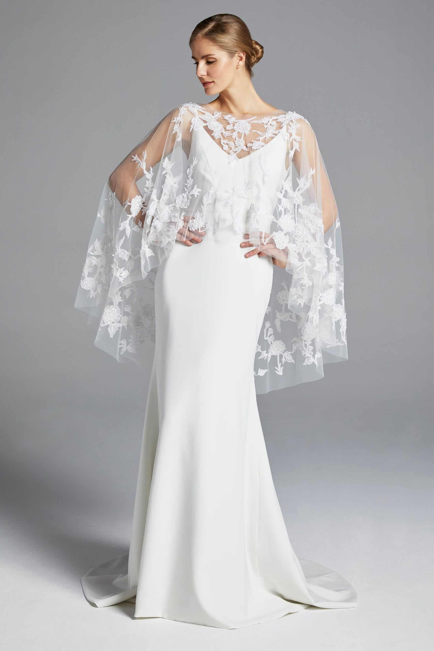 wedding dress with a see-through cape by Anne Barge