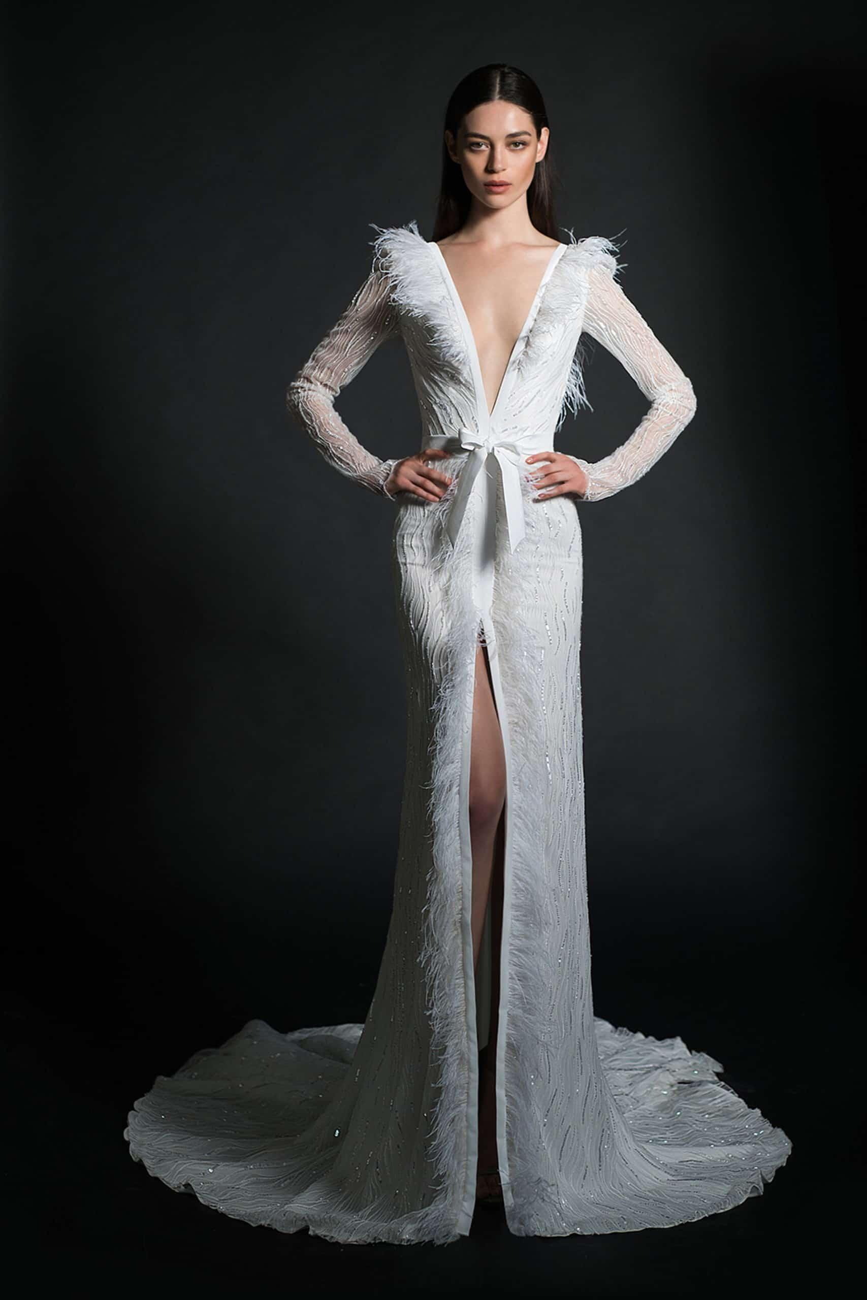 v neck wedding dress with a small bow around the waist by Inbal Dror