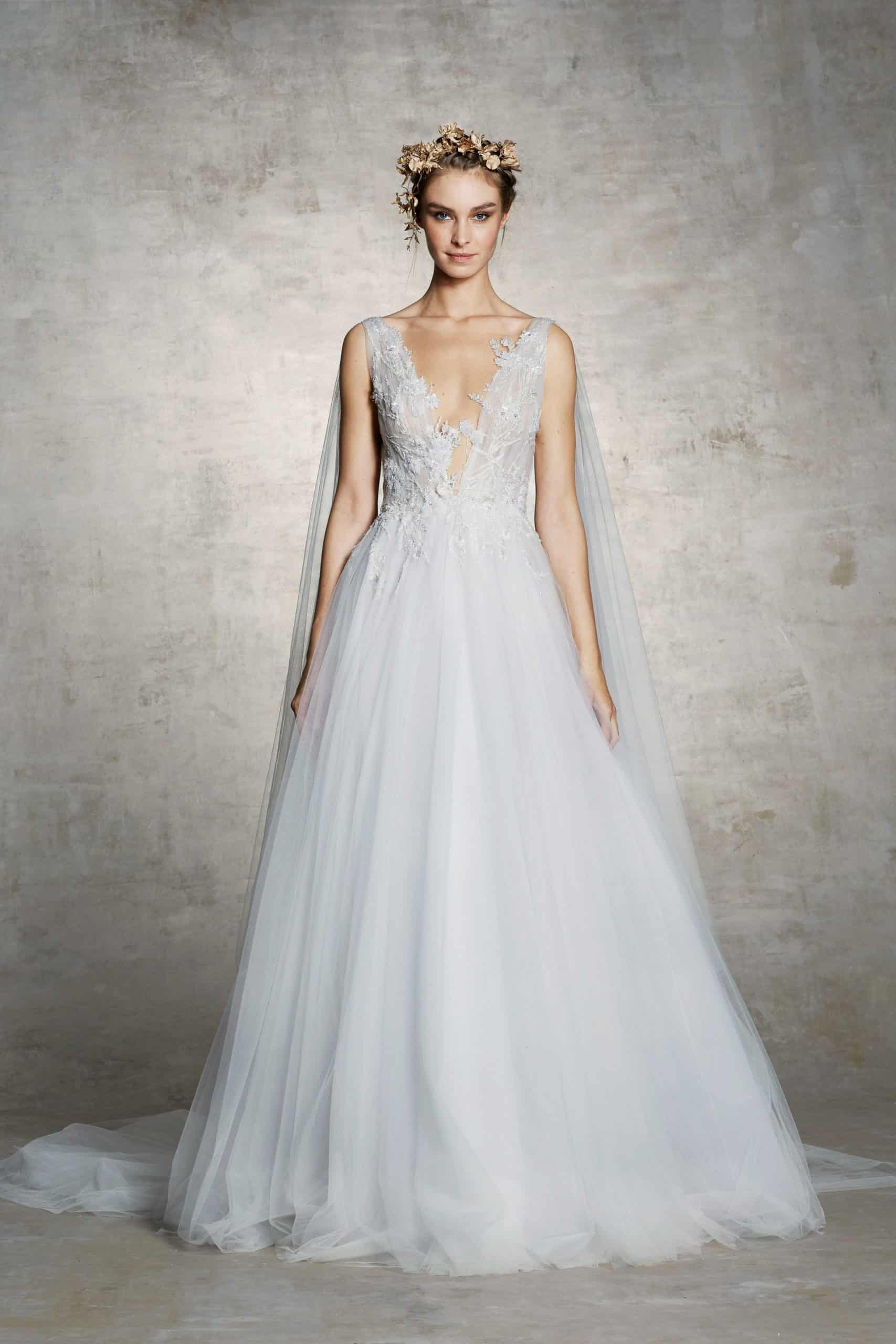 wedding dress with a tulle cape by Marchesa