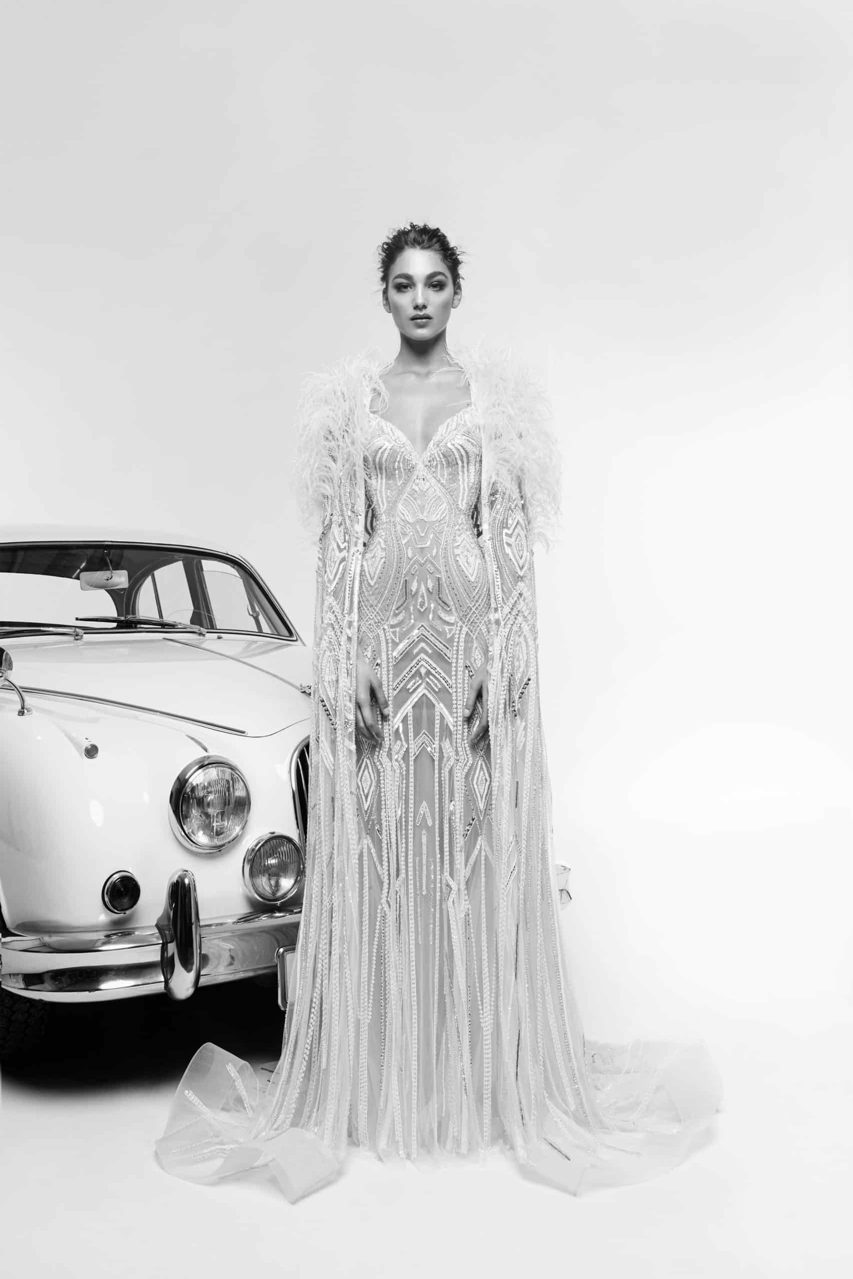 lace wedding dress with a lace cape by Zuhair Murad