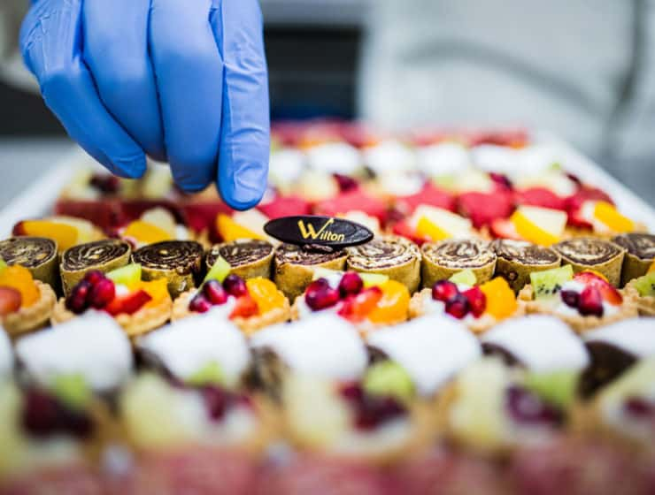 Chef decorating dessert platter for weddings, by Wilton Catering in Cyprus.