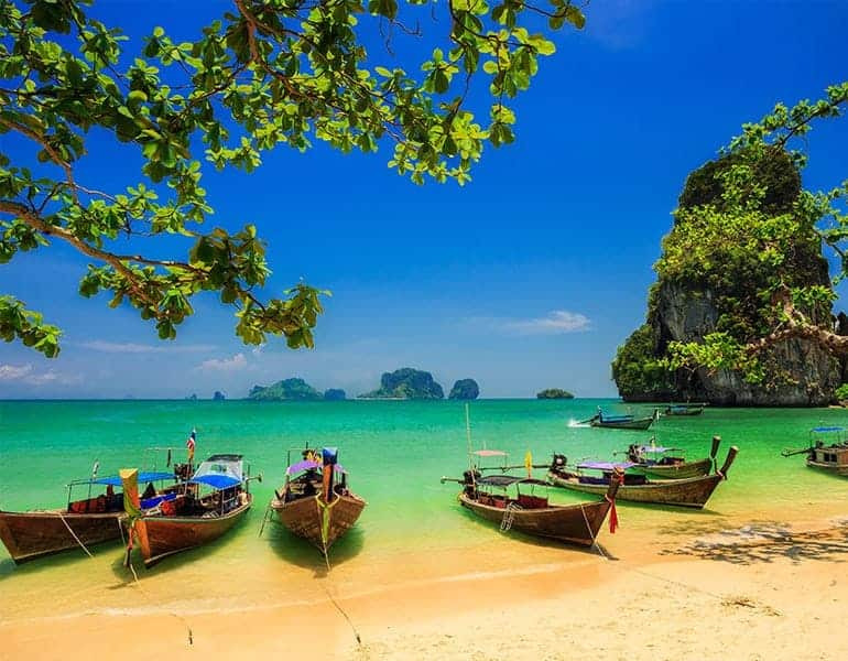Tropical beach and clear blue skies in Asia, a destination offered by Xenos Travel.