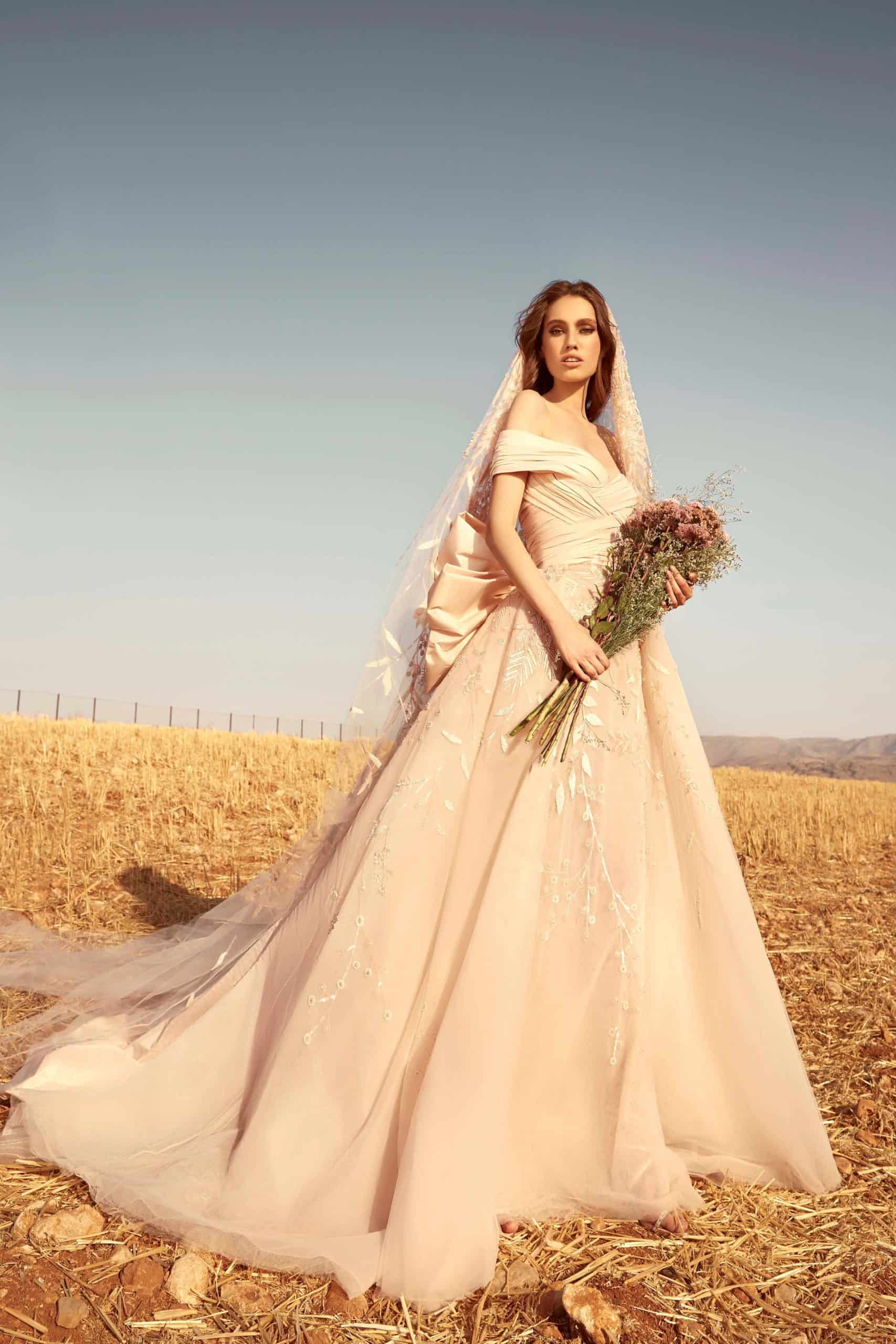 beige tulle wedding dress with back large satin bow by Zuhair Murad