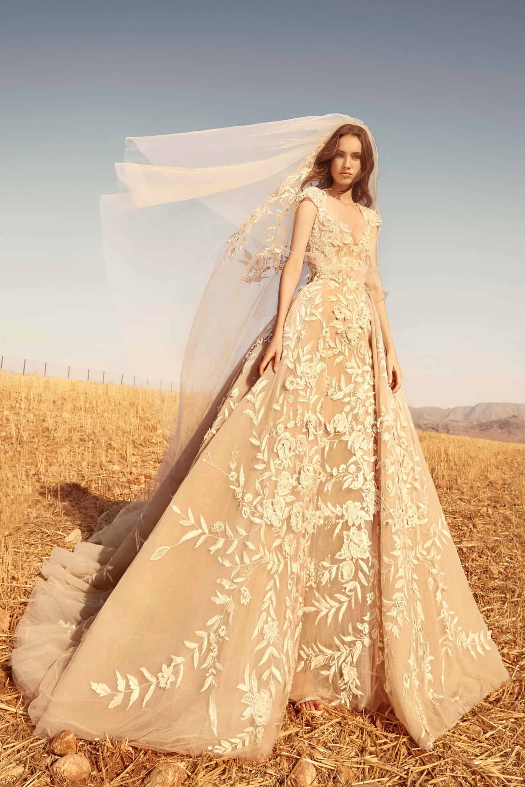 beige wedding dress with embossed flower lace by Zuhair Murad
