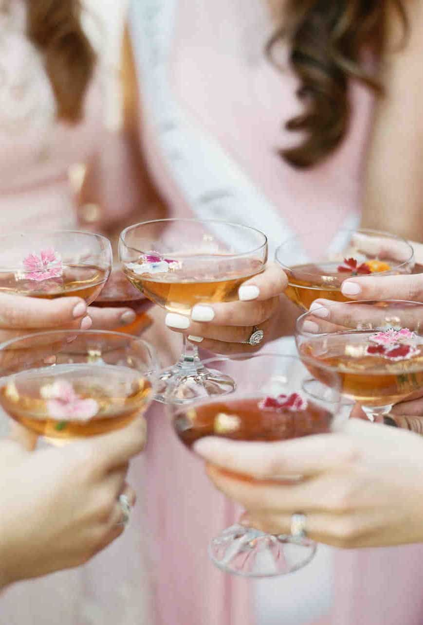 bride and bridesmaids drinking cocktail drinks
