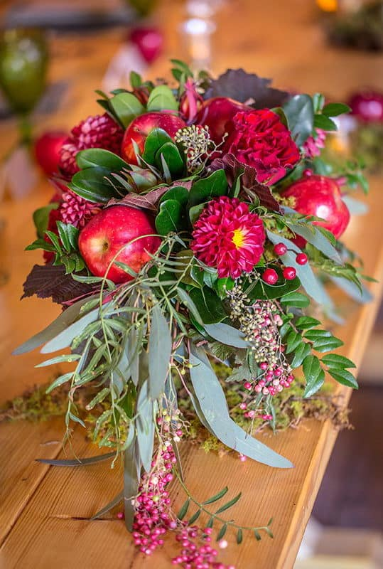 red wedding bouquet with apples and berries
