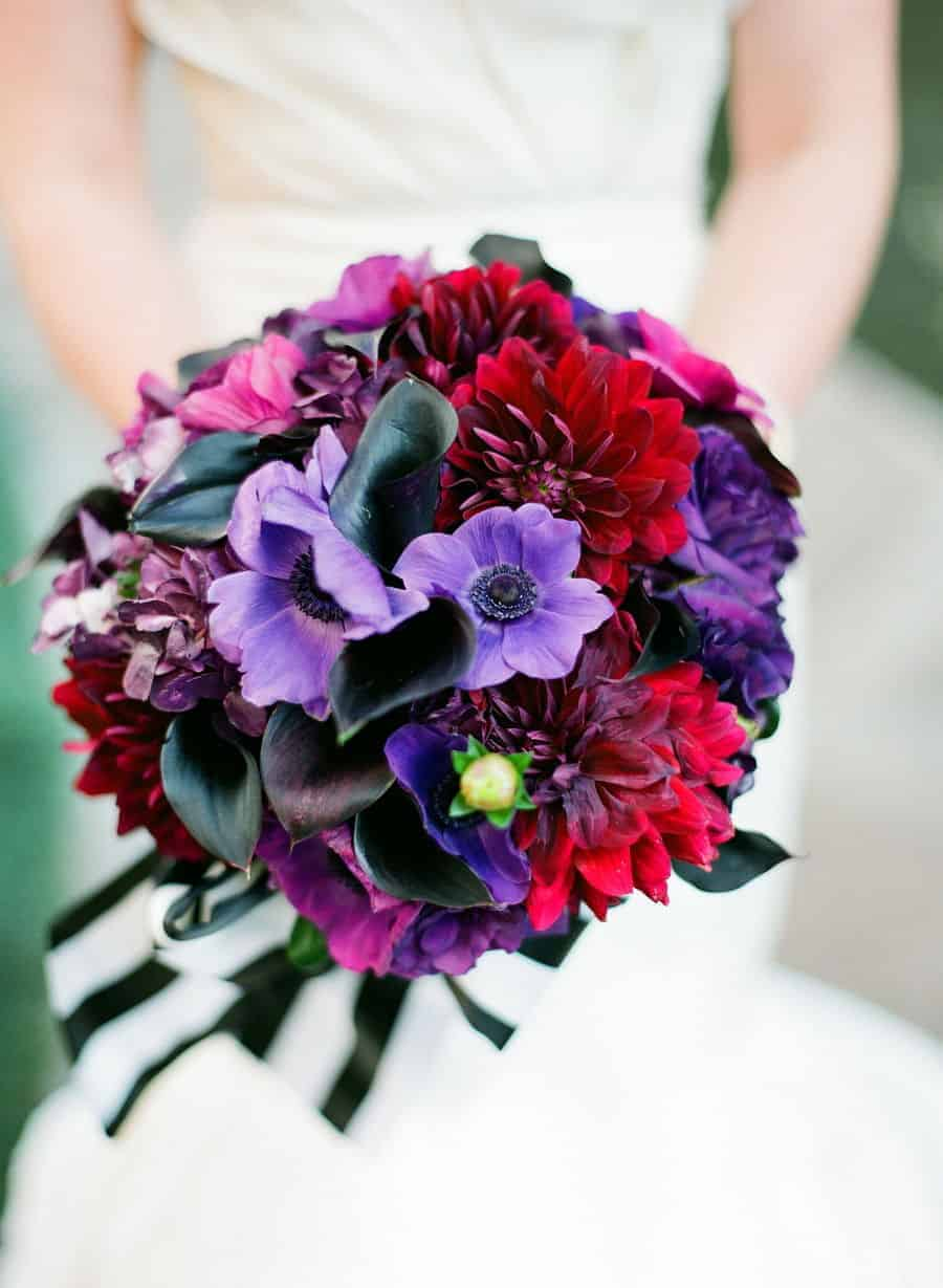 wedding bouquet with lilac anemones and ribbon with stripes