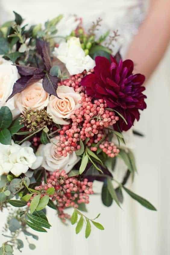 wedding bouquet with pink snowberries