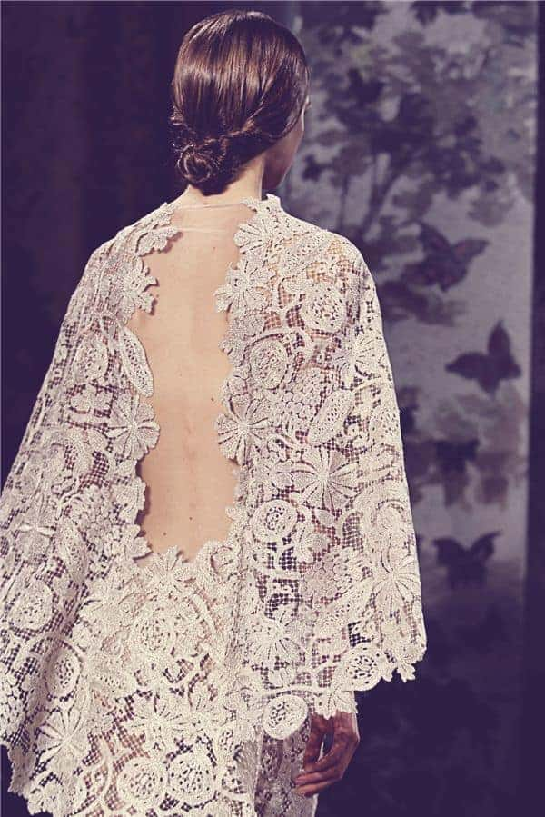 wedding dress with a heavy laced cape