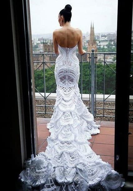 a mermaid line wedding dress with a spanish style tail