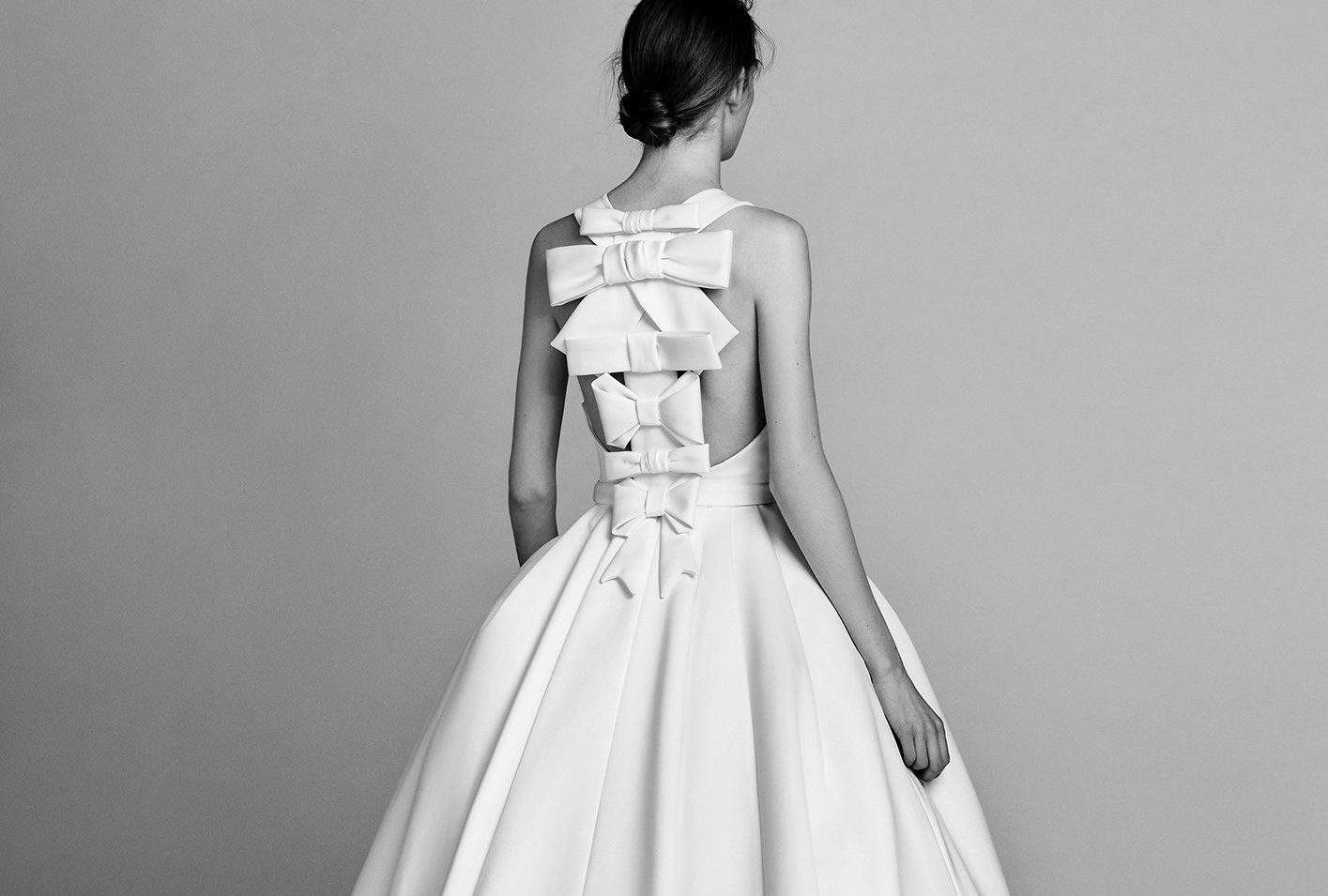 wedding dress with oversized bows on back by Victor and Rolf