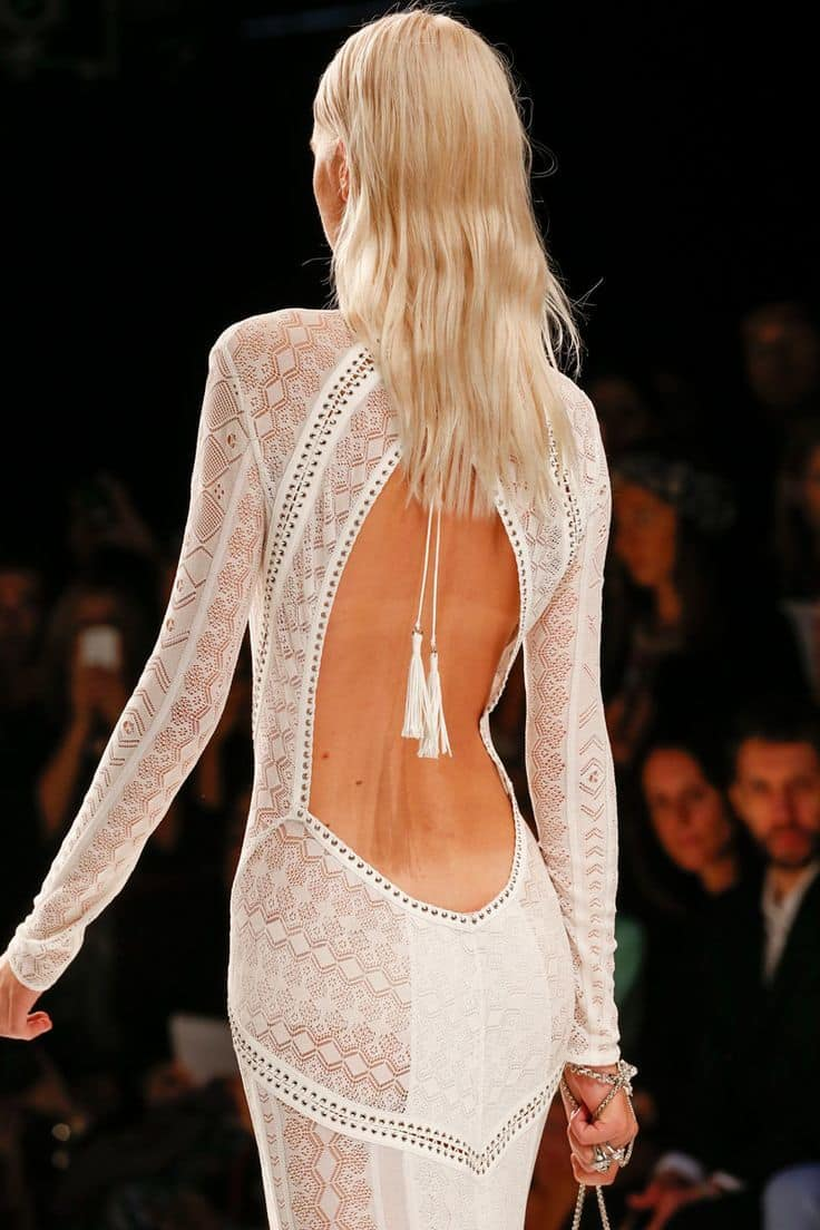 wedding dress with a highly revealing back