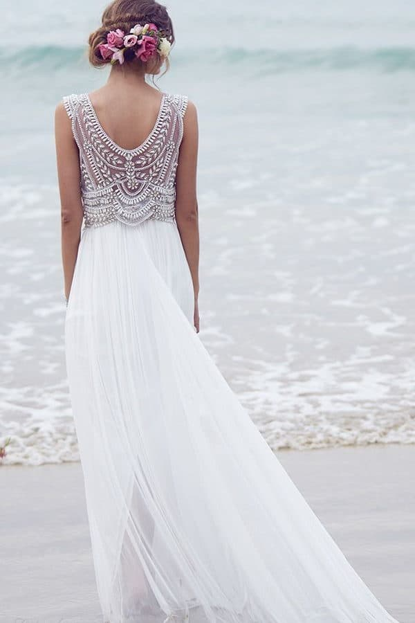 bride at the beach with a wedding dress with lace back side