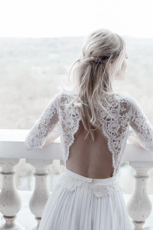 bride with a wedding dress with lace back side
