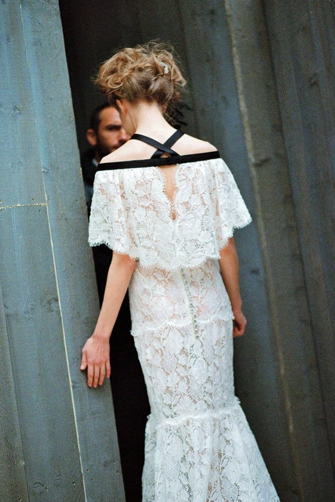 bride with a laced crop top with black silk ribbon detail wedding dress