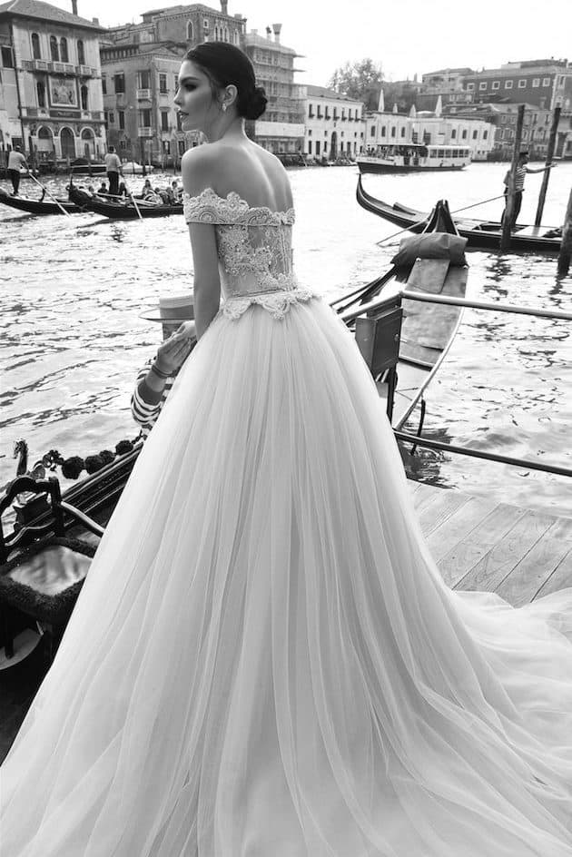 bride in Italy with a line wedding dress with corset fabric with distinctive lacing on the back